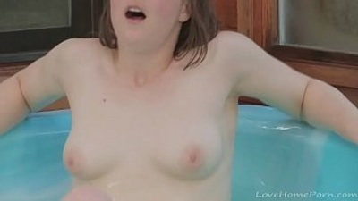 Brunette masturbates with a toy in the pool