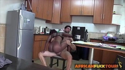 Horny white stud fucks a busty redhead chick in a kitchen