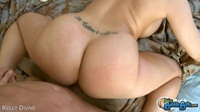 Big assed Kelly Divine riding a large cock
