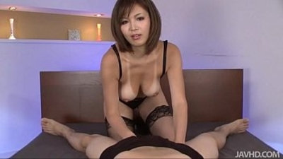 Sexy tanned Mai Kuroki in bed playing with horny guys cock making him cum